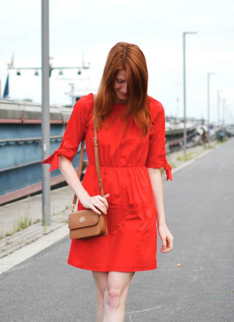 Redhead wearing red