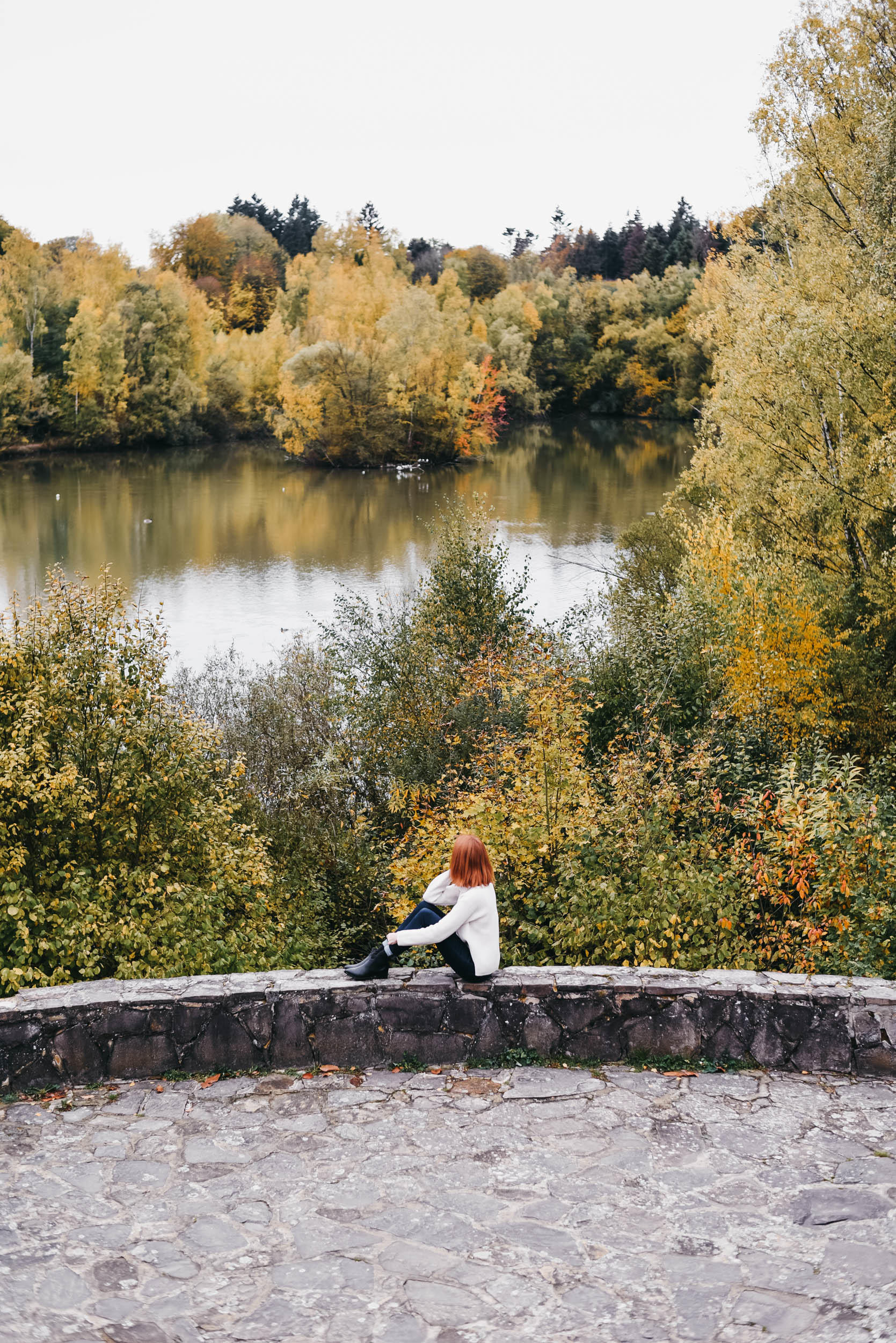 Girl looking out over the pond at Château de la Hulpe Brussels
