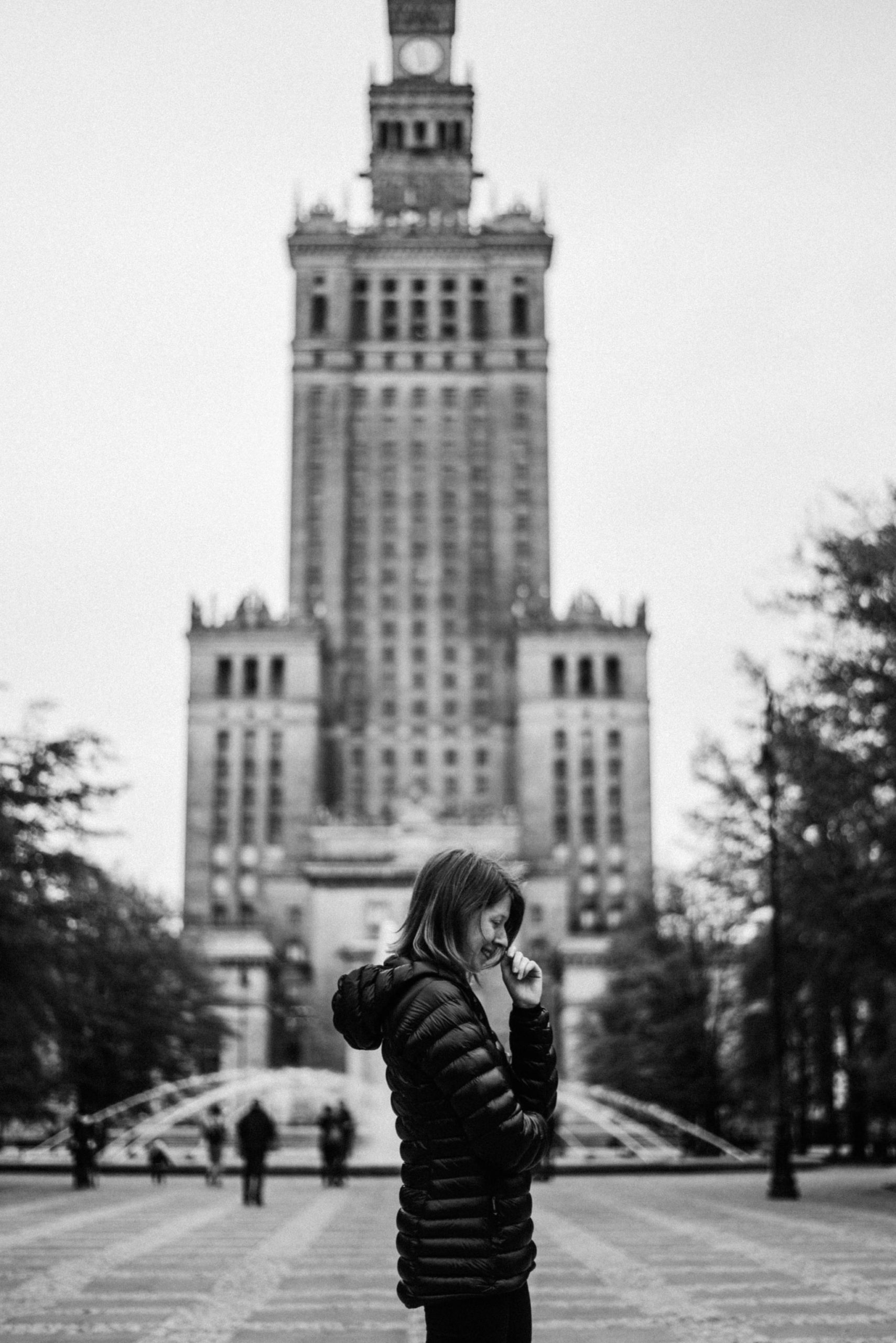 Girl in front of Warsaw palace of culture and science
