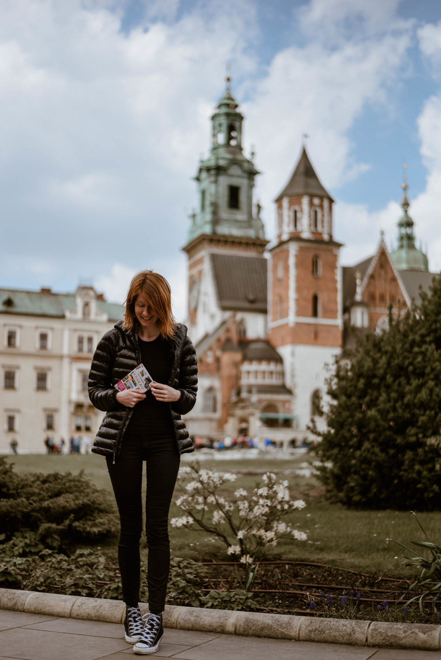 Girl in front of Wawel Royal Palace in Krakow