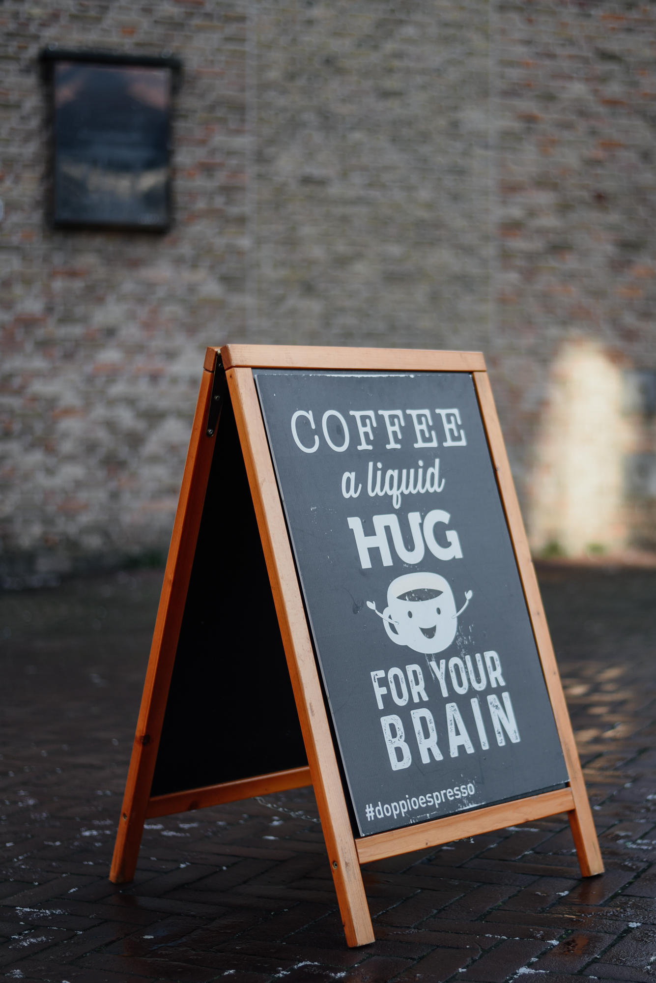 street signs that says Coffee, A Liquid Hug For Your Brain