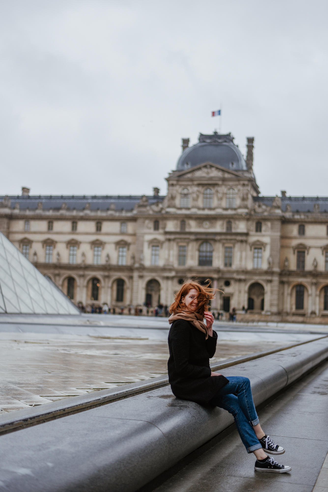 Girl in front of The Liuvre Museum in Paris