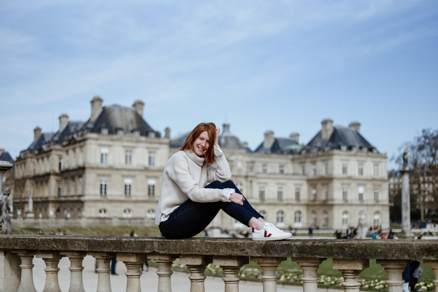 girl in front of castle Jardin De Luxembourg Paris