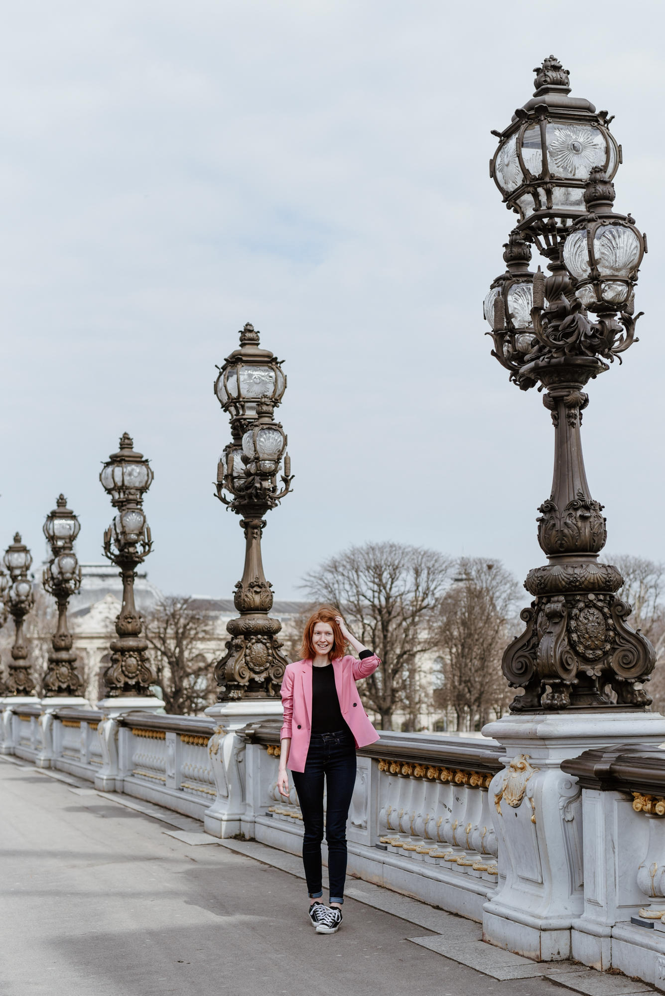 girl on Pont Alexandre III in Paris