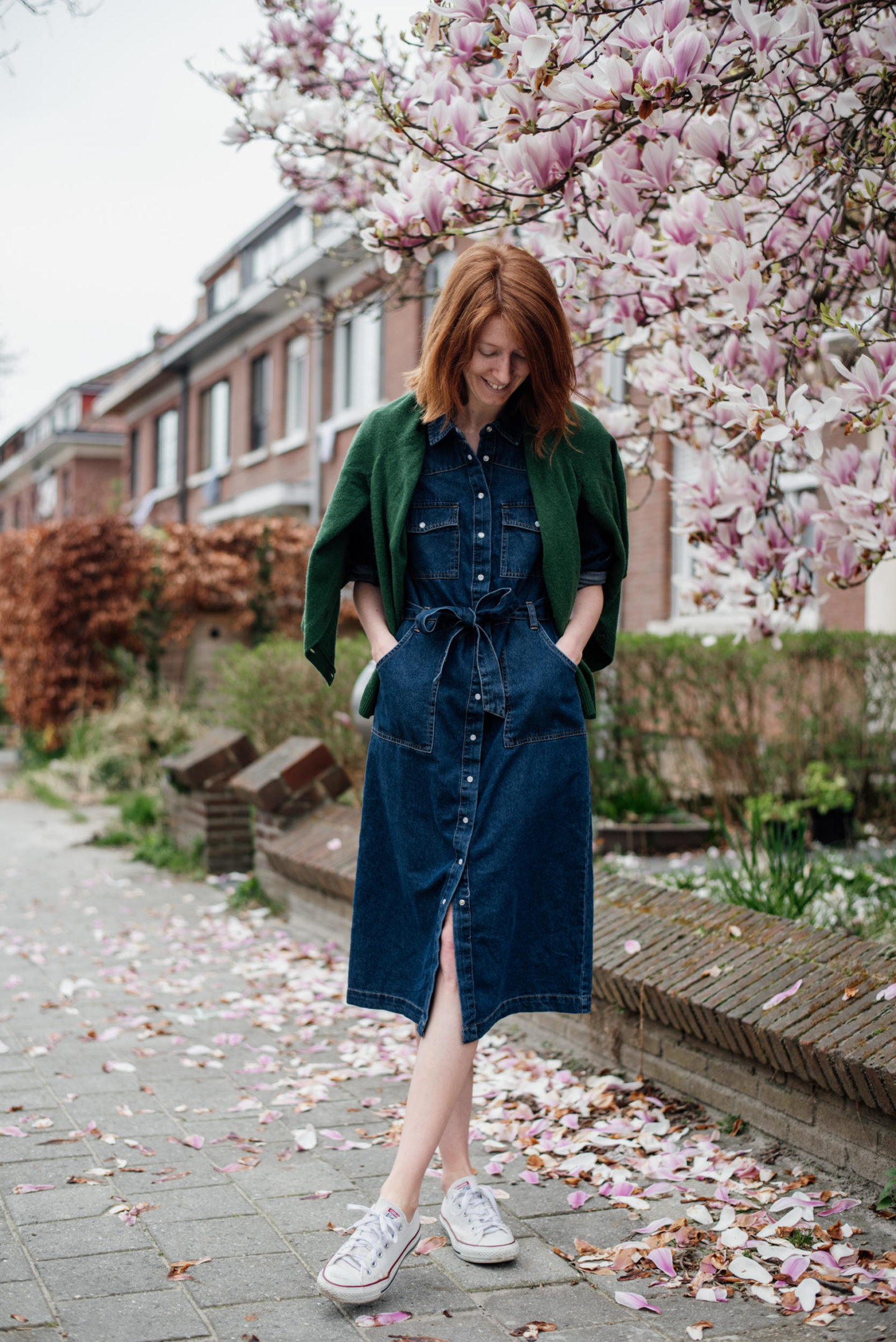 women's outfit with a blue jeans dress