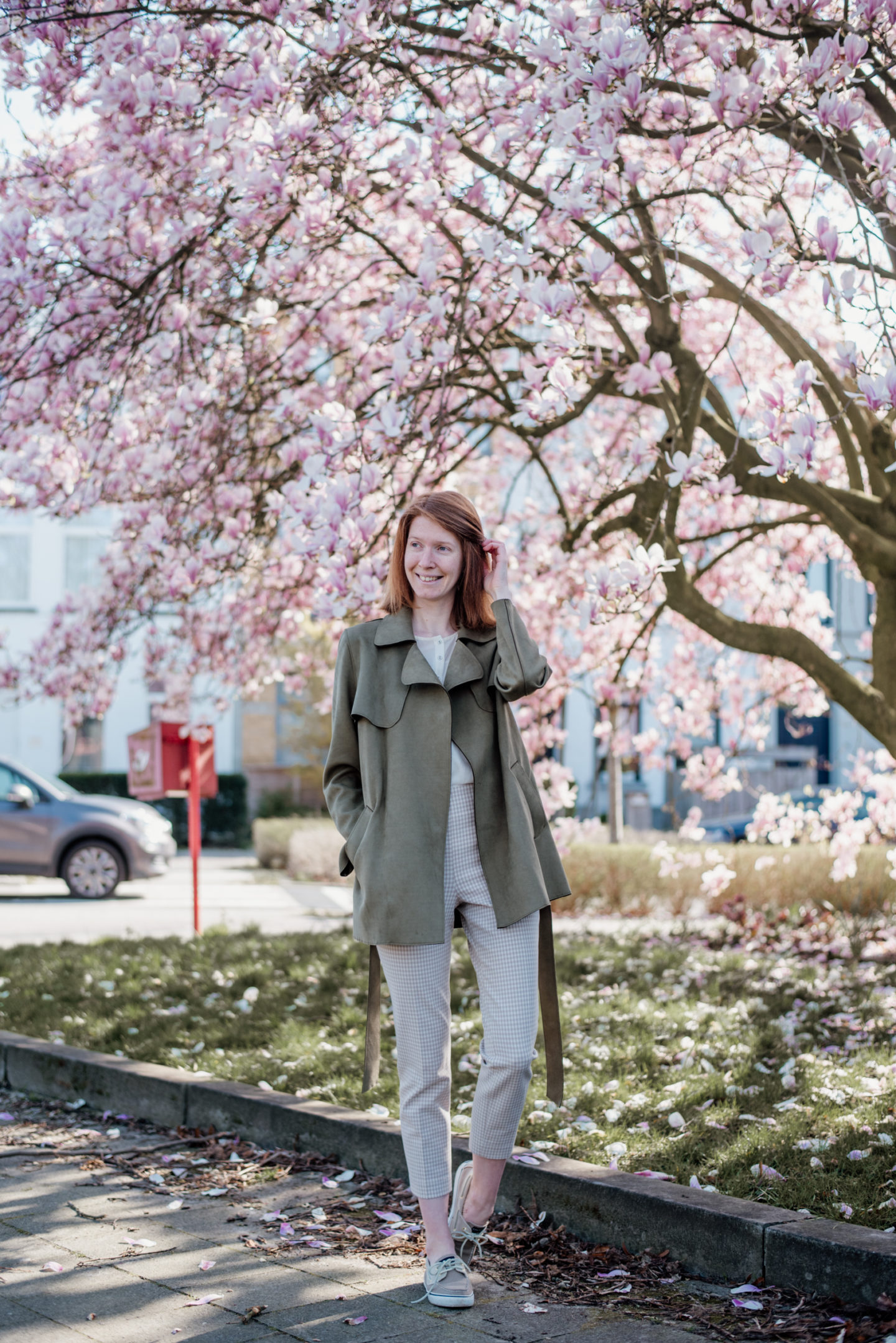 women's spring outfit with olive suede jacket